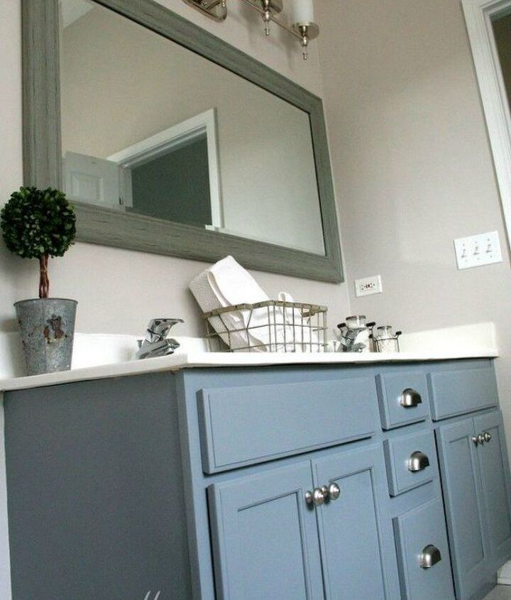 s 11 ways to transform your bathroom vanity without replacing it, bathroom ideas, Add new handles to drawers