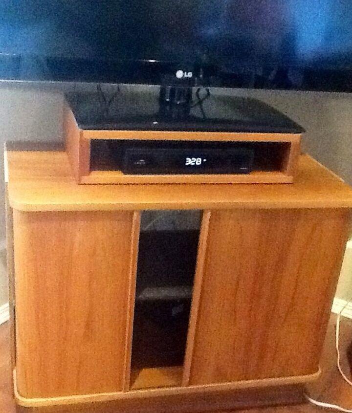 TV stand with tamboured doors, great storage.