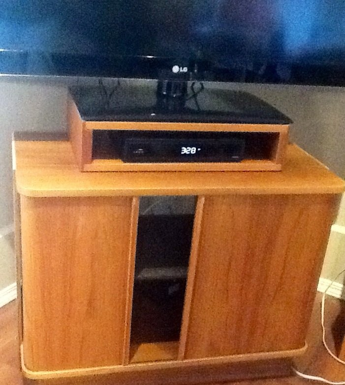 TV stand with tamboured doors, great storage.