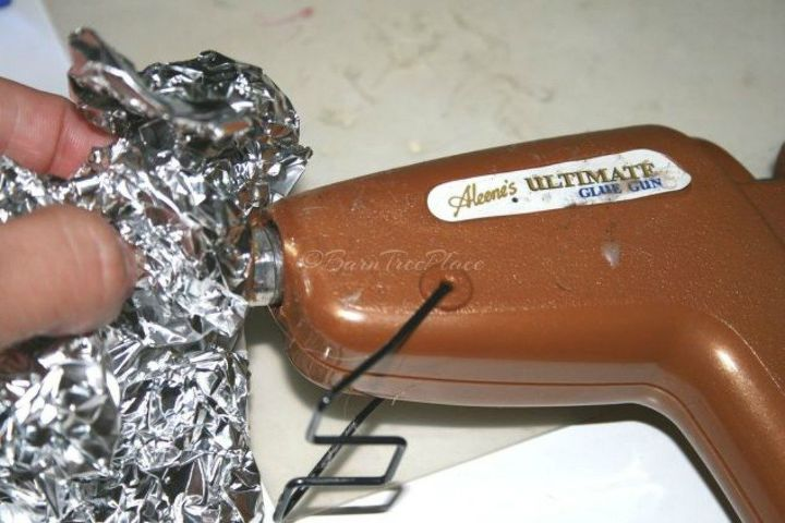 s here s why you should be buying extra rolls of tin foil, cleaning tips, It quickly cleans your hot glue gun