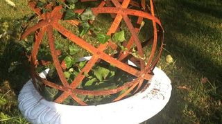 , rusted garden orb Just set it up and planted some ivy to weave through the orb