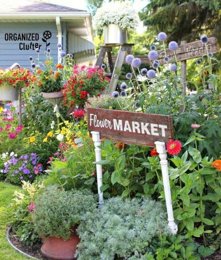 s how to transform your backyard into a junk garden, Include wooden signs for a farm feel