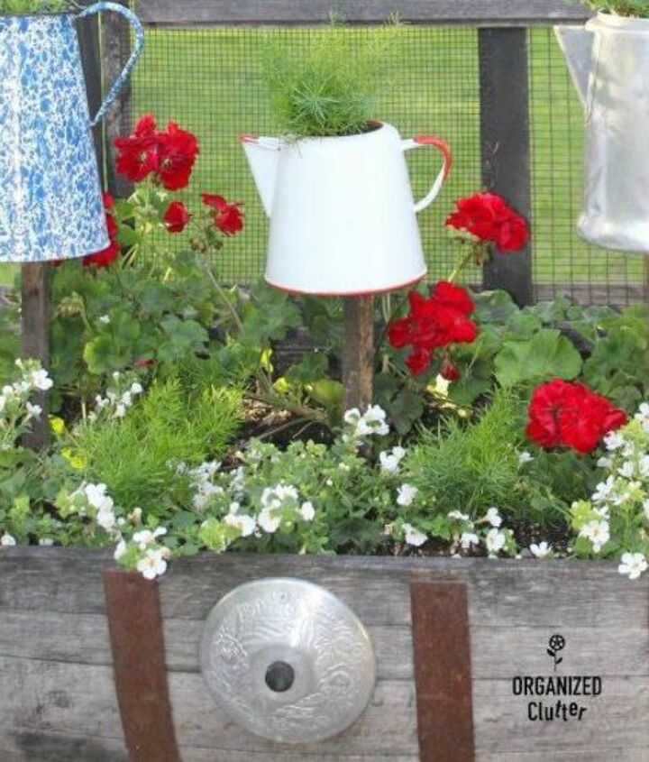s how to transform your backyard into a junk garden, Use old tea pots to host flowers