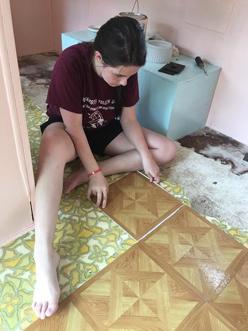 New floor tiles going down