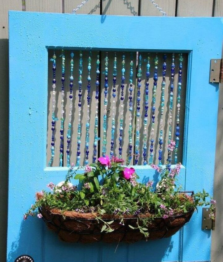 s 15 brilliant ways to upcycle old doors, doors, Transform it into a colorful hanging planter