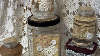 , Twine book pages lace buttons burlap cutouts and ribbon rosettes Three are orange juice containers one is a nut jar and the other is a Hershey s cocoa container