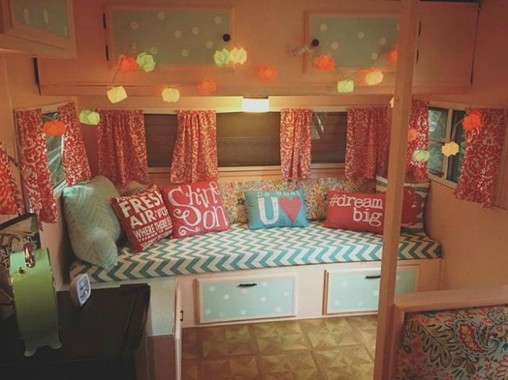 s 10 incredible camper makeovers you ll wish you d seen sooner, This glamper with the fun throw pillows