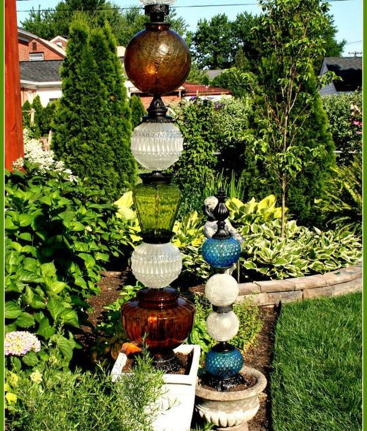 s why everyone is loving these cheap glass globes, lighting, repurposing upcycling, They can be stacked up into garden totems