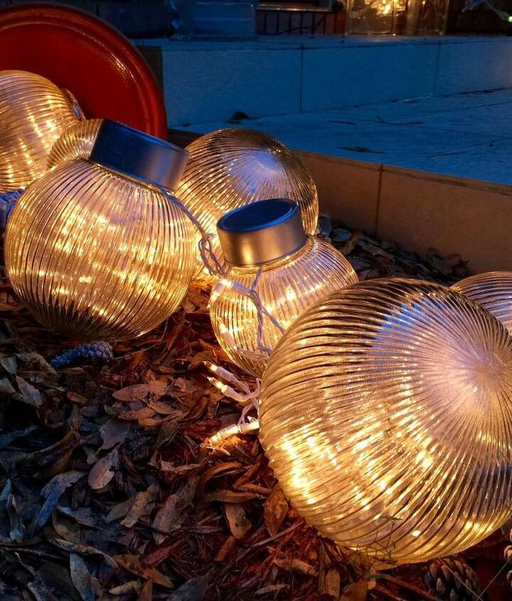 s why everyone is loving these cheap glass globes, lighting, repurposing upcycling, They look whimsical filled with fairy lights