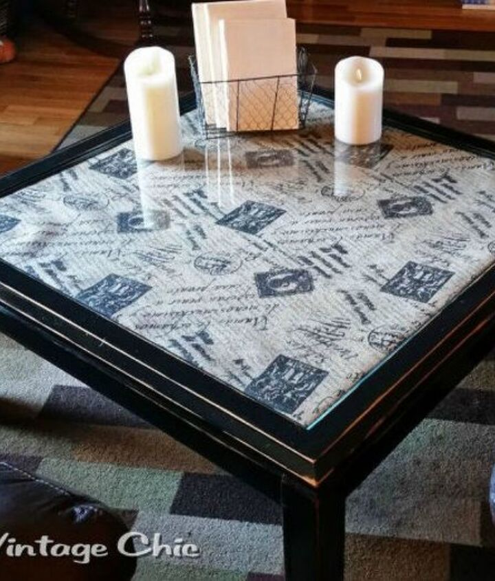 s your quick catalog of gorgeous coffee table makeover ideas, painted furniture, This fabric topped one with a glass cover