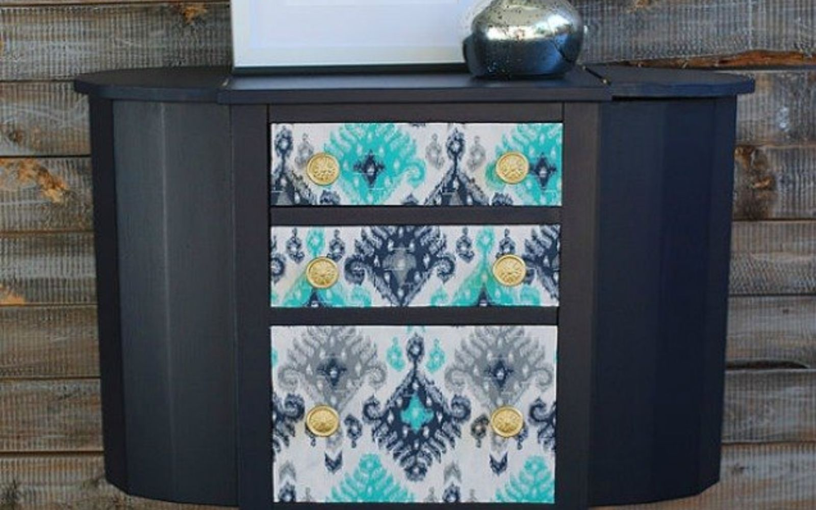 s 12 wildly creative ways to use your old sewing table, painted furniture, Decoupage it with colorful fabric