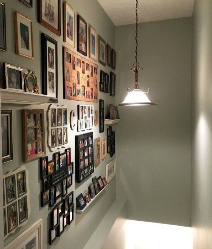 s if your stairway walls are empty here s what you re missing, wall decor, A big gallery wall of family pictures