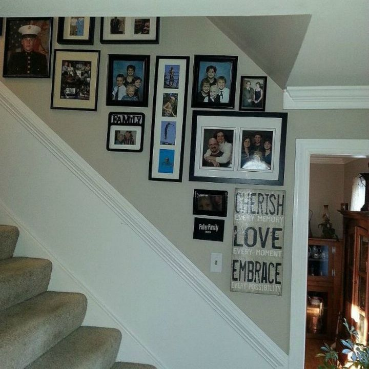 s if your stairway walls are empty here s what you re missing, wall decor, A cascading wall of loving words and photos