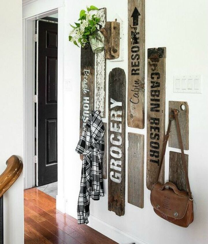 s if your stairway walls are empty here s what you re missing, wall decor, A staggering effect of rustic fence boards