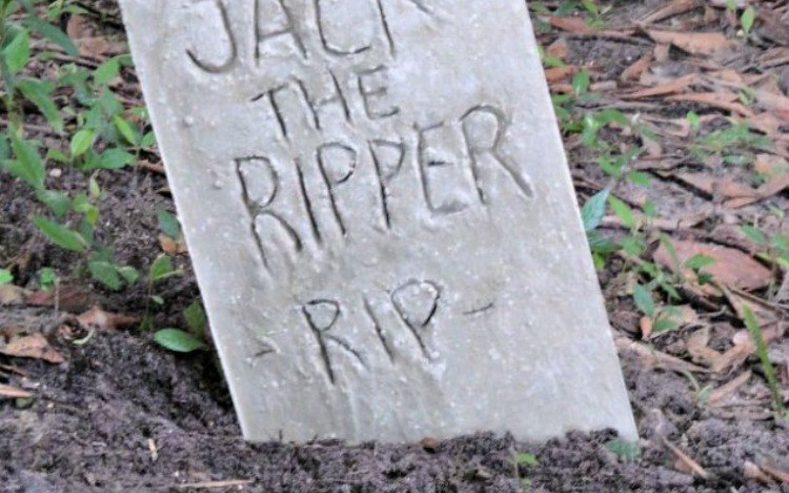 s don t throw out that old cookie sheet before you see these ideas, repurposing upcycling, Use concrete to make a halloween tombstone