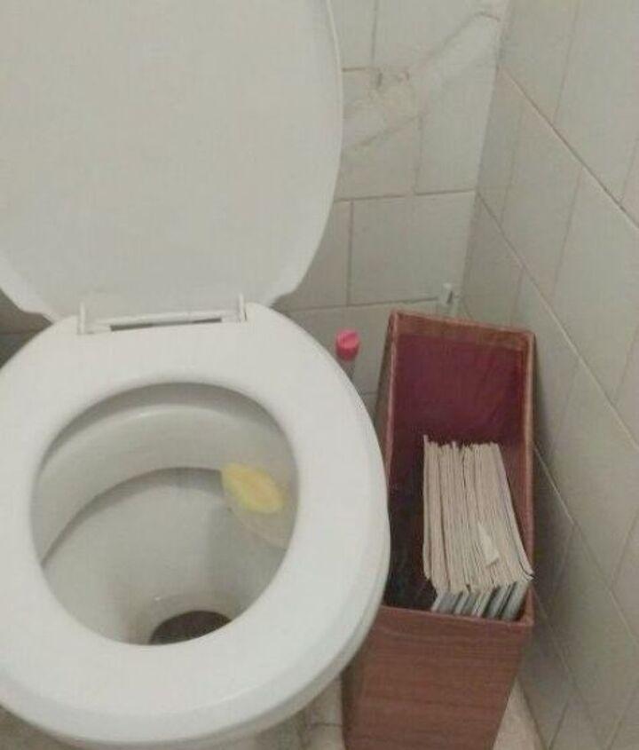 s 11 space saving hacks for your tiny bathroom, bathroom ideas, Build a magazine holder out of cardboard