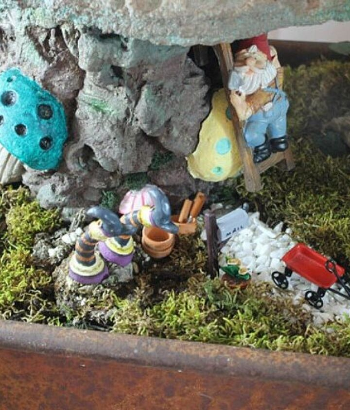s make your neighbors giggle with these 9 halloween fairy garden ideas, gardening, halloween decorations, seasonal holiday decor, Or add in witches fairy legs for some fun