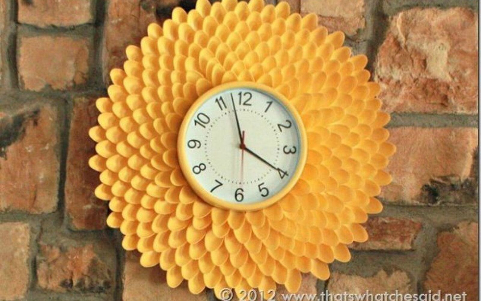 s 11 brilliant ways to reuse plastic spoons, Glue them into a bright chrysanthemum clock