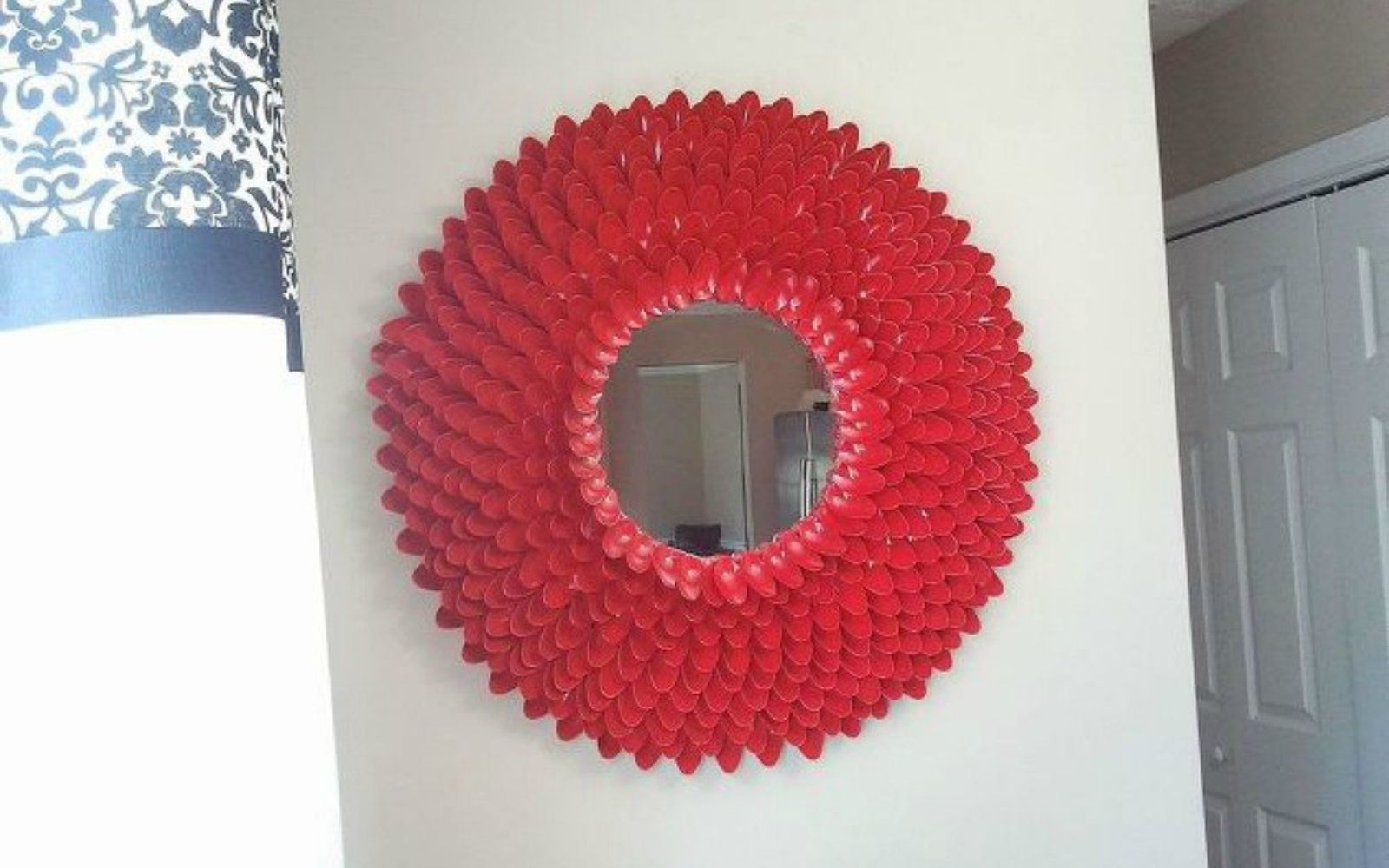 s 11 brilliant ways to reuse plastic spoons, Or turn them into a chic circle mirror