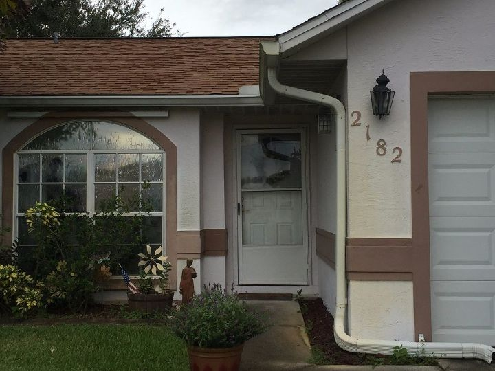 q painting front door and removing window film, curb appeal, doors, exterior home painting, painting