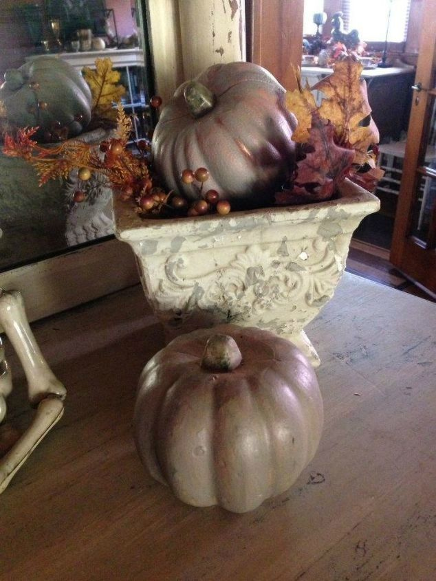 s 10 spook tacular ways to dress up your dollar store pumpkins, halloween decorations, seasonal holiday decor, Give them a chic look with metallic paint