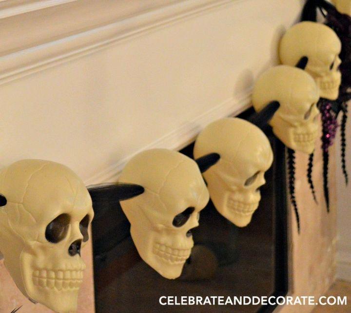 diy dollar store skull halloween garland, halloween decorations, seasonal holiday decor