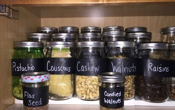 labeling mason jars in the pantry, closet, mason jars