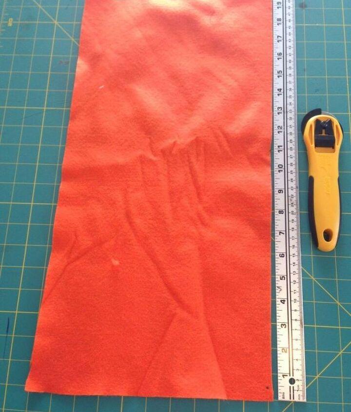 Orange felt fabric, ruler and rotary cutter