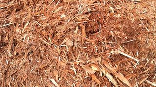 , A fibrous mulch will also work well as it tends to hold onto itself as a mass rather than individual chips
