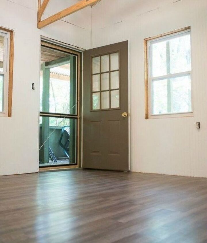 s shock your guests with these shoe string budget flooring ideas, flooring, Install laminate flooring with a wood texture