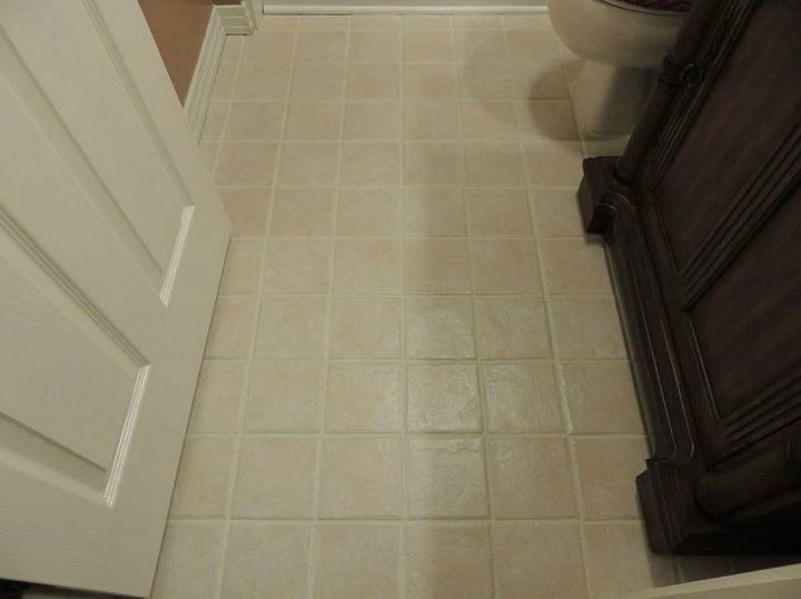 s shock your guests with these shoe string budget flooring ideas, flooring, Paint the grout to give your tile a new look