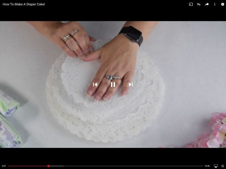 Attach doilies to cake rounds.