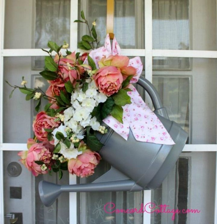 s tired of wreaths try these ideas instead , crafts, wreaths, Hang a watering can with some flowers