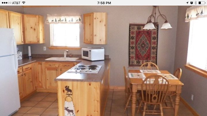 cabin kitchen and dining space renovation diy, kitchen design, The before photo from realtor com