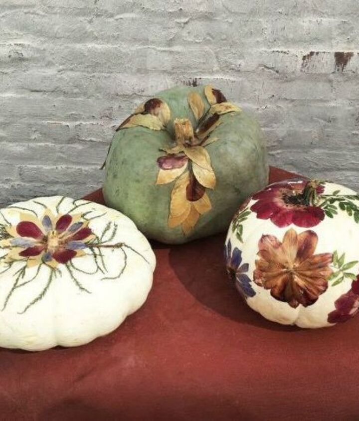 s 13 popular ways to decorate a pumpkin with little or no carving, Glue on some pressed leaves and flowers