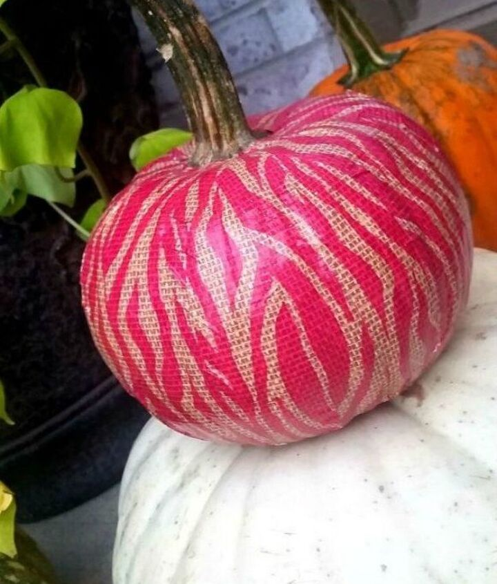 s 13 popular ways to decorate a pumpkin with little or no carving, Stick on some patterned duct tape