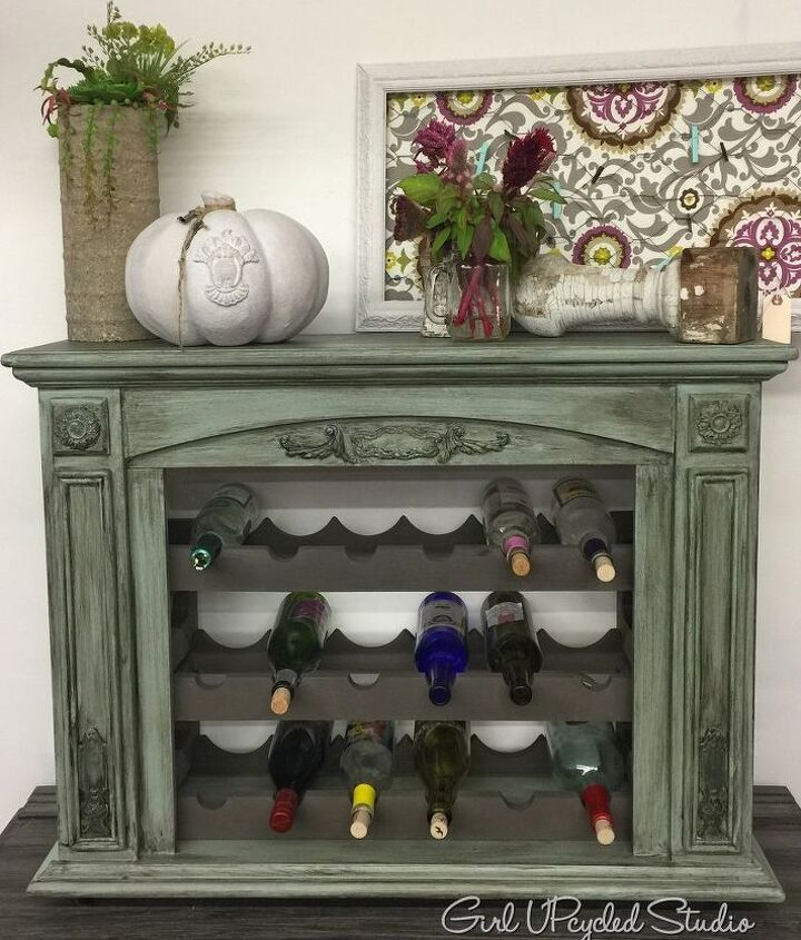 fireplace is beautifully upcycled into an aged wine rack, fireplaces mantels
