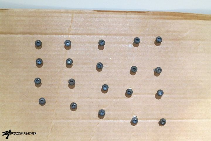 Screws clear coated on piece of cardboard
