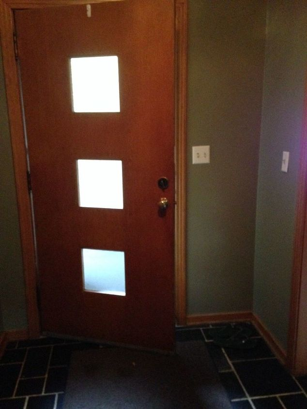q entryway with black tile with white grout, cosmetic changes, home decor, home decor dilemma, home improvement, Front door needs some color too any suggestions