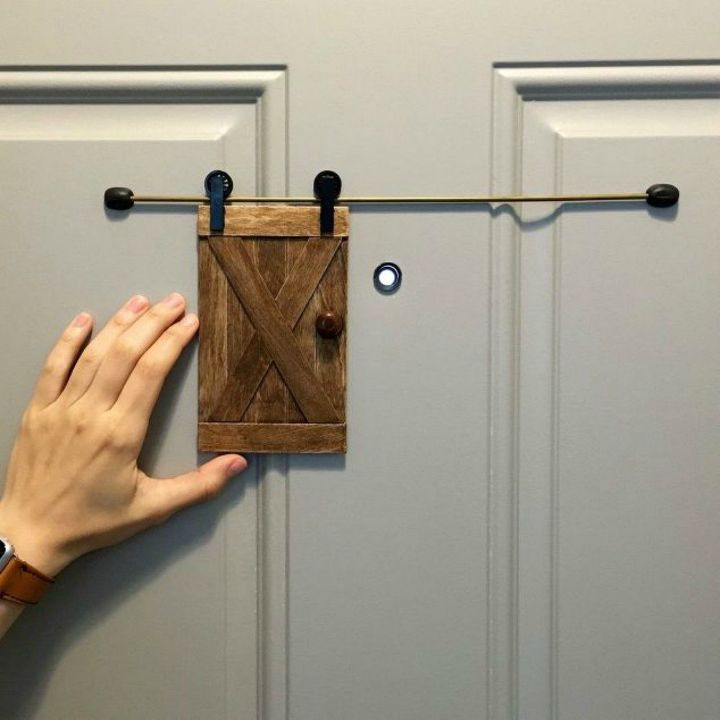 s 10 easy ways to fix your old door in under an hour, doors, Add a mini sliding barn door peephole cover