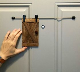 Add a mini sliding barn door peephole cover & 10 Easy Ways to Fix Your Old Door in Under an Hour | Hometalk pezcame.com