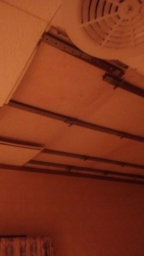 Ceiling tiles falling out and metal strips showing. Trying to figure out how I can maybe leave the metal strips and put something really different up there.