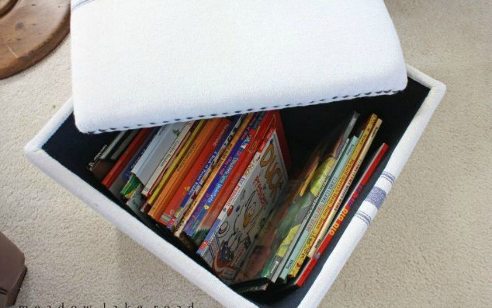s 11 amazing toy storage ideas from highly organized moms, organizing, storage ideas, Pile books in ottomans