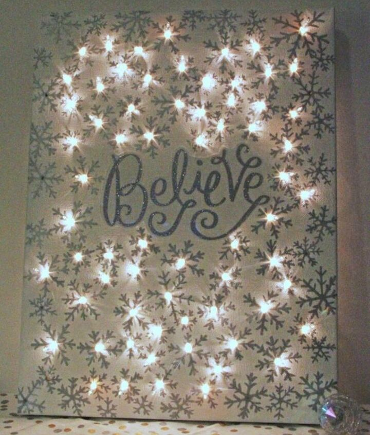 s hang your christmas lights in these 10 breathtaking spots, On a lighted Christmas canvas sign