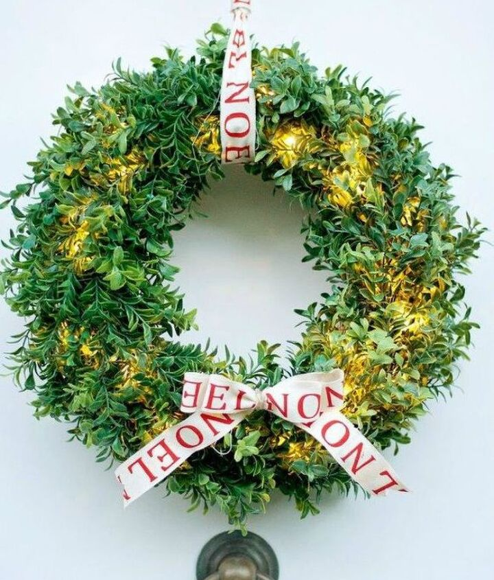 s hang your christmas lights in these 10 breathtaking spots, On your door in a boxwood wreath