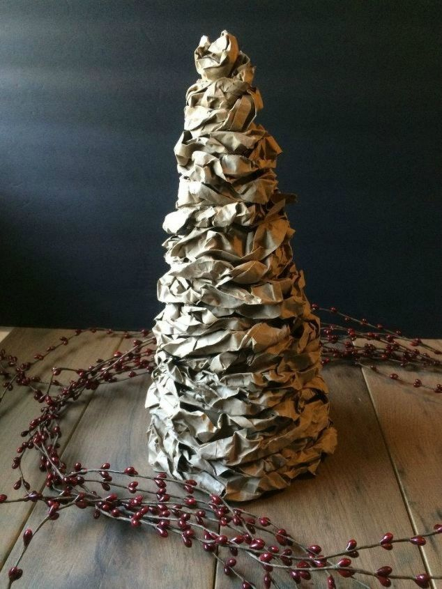 s cut up cardboard for these breathtaking christmas ideas, christmas decorations, Roll them into mini Christmas trees