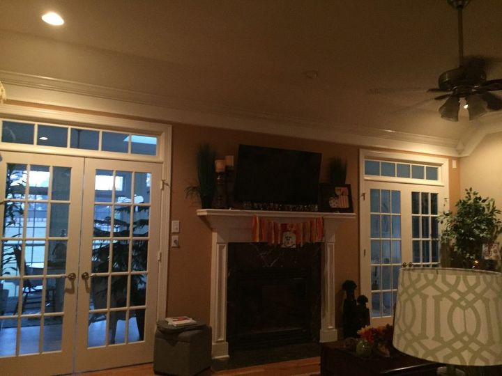 That's the living room with the French doors. Would you put window treaments over and what kind?