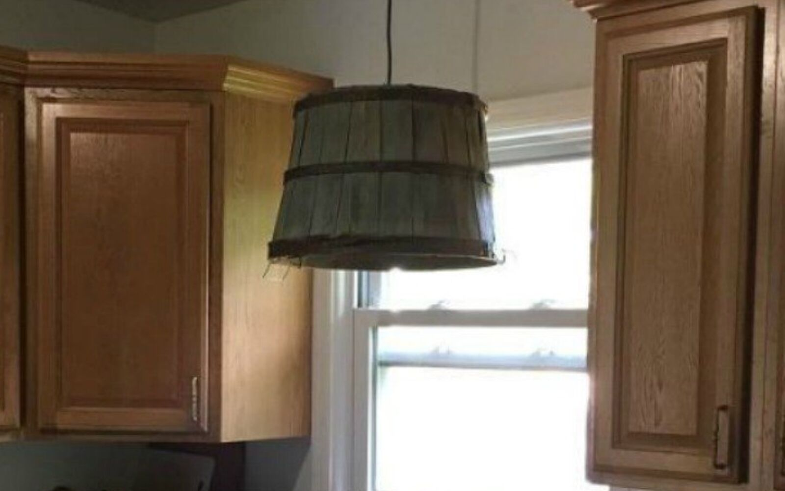 s grab an old basket for these clever ideas, crafts, Use it as a light fixture