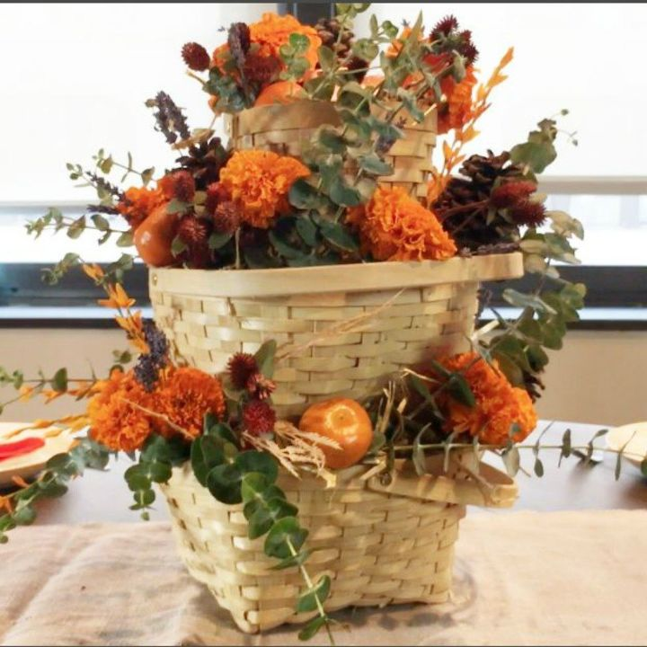 s grab an old basket for these clever ideas, crafts, Stack it into a fall centerpiece