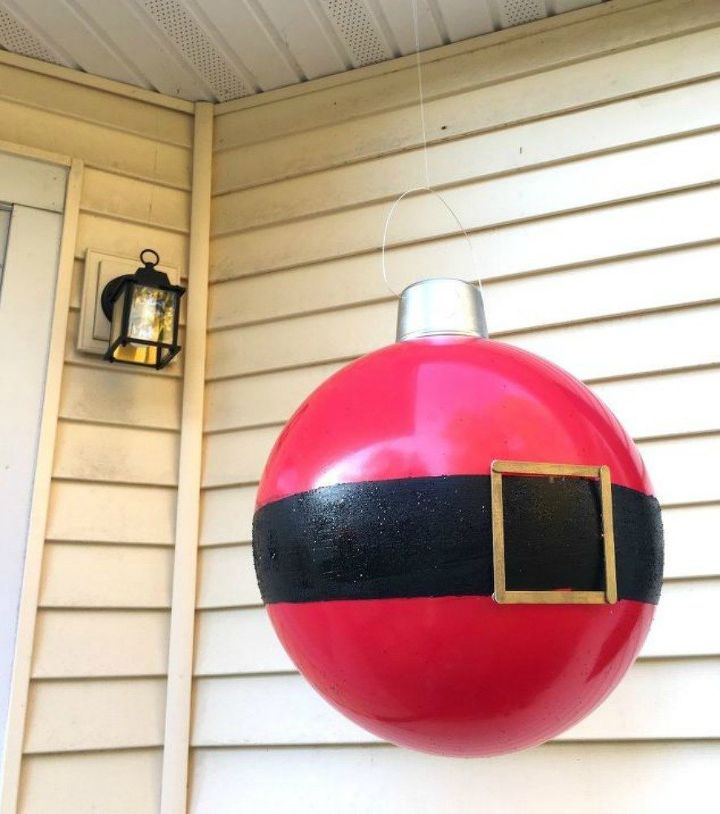 s make your porch look amazing with these diy christmas ideas, christmas decorations, Paint big bouncy balls into Santa ornaments